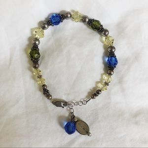 """Beaded bracelet with """"remember"""" tag"""